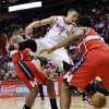 Houston Rockets\' Jeremy Lin (7) loses the ball between Washington Wizards\' Bradley Beal, left, and Kevin Seraphin in the second half of an NBA basketball game, Wednesday, Dec. 12, 2012, in Houston. The Rockets won 99-93. (AP Photo/Pat Sullivan)