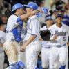 UCLA closing pitcher David Berg, right, and catcher Shane Zeile hug after an NCAA College World Series baseball game against North Carolina in Omaha, Neb., Friday, June 21, 2013. UCLA won 4-1. (AP Photo/Francis Gardler)