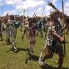 A group of Zulu warriors walk near a public viewing tent during the funeral service of former South African president Nelson Mandela in Qunu, South Africa, Sunday, Dec. 15, 2013. (AP Photo/Akmal Rajput)