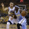 Denver Nuggets\' Ty Lawson, right, drives the ball past Golden State Warriors\' Stephen Curry (30) during the first half of Game 4 in a first-round NBA basketball playoff series on Sunday, April 28, 2013, in Oakland, Calif. (AP Photo/Ben Margot)