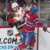 Photo - Montreal Canadiens' Douglas Murray, right, collides with Calgary Flames' TJ Galiardi during the second period of an NHL hockey game Tuesday, Feb. 4, 2014, in Montreal. (AP Photo/The Canadian Press, Graham Hughes)