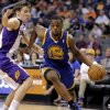 Golden State Warriors\' Harrison Barnes, right, drives against Phoenix Suns\' Goran Dragic, of Slovenia, during the first half of an NBA basketball game on Friday, April 5, 2013, in Phoenix. (AP Photo/Matt York)