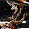 Detroit Pistons\' Greg Monroe, right, gets off a shot as Phoenix Suns\' Marcin Gortat, left, of Poland, defends in the first half of an NBA basketball game on Friday, Nov. 2, 2012, in Phoenix.(AP Photo/Ross D. Franklin)