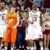 OU\'s Willie Warren (13) celebrates in front of OSU\'s Keiton Page (12) in the Sooners 62-57 overtime win in the college bedlam basketball game between The University of Oklahoma Sooners (OU) and Oklahoma State University University Cowboys (OSU) at the Lloyd Noble Center on Monday, Jan. 11, 2010, in Norman, Okla. Photo by Chris Lansdberger, The Oklahoman
