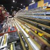 Photo - Train enthusiasts look through hundreds of model train cars during the OKC Train Show at State Fair Park in Oklahoma City, OK, Saturday, December 1, 2012,  By Paul Hellstern, The Oklahoman