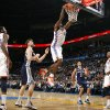 Oklahoma City\'s Serge Ibaka (9) dunks during the NBA basketball game between the Oklahoma City Thunder and the Memphis Grizzlies, Saturday, Jan. 8, 2011, at the Oklahoma City Arena. Photo by Sarah Phipps, The Oklahoman