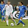 Italy\'s Andrea Pirlo, right, and England\'s Wayne Rooney vie for the ball during the Euro 2012 soccer championship quarterfinal match between England and Italy in Kiev, Ukraine, Sunday, June 24, 2012. (AP Photo/Gregorio Borgia)