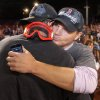 Boston Red Sox general manager Ben Cherington, right, is embraced by a player after the Red Sox clinched the AL East title with a 6-3 win over the Toronto Blue Jays in a baseball game at Fenway Park, Friday, Sept. 20, 2013, in Boston. (AP Photo/Charles Krupa)