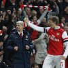 Photo - Arsenal's manager Arsene Wenger, left, celebrates their win against Liverpool at the end of their English FA Cup fifth round soccer match at Emirates Stadium in London, Sunday, Feb. 16, 2014. (AP Photo/Sang Tan)