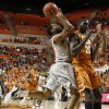 Oklahoma State\'s Brian Williams (4) runs into Texas\' Alexis Wangmene (20) during an NCAA college basketball game between Oklahoma State University (OSU) and the University of Texas (UT) at Gallagher-Iba Arena in Stillwater, Okla., Saturday, Feb. 18, 2012. Oklahoma State won 90-78. Photo by Bryan Terry, The Oklahoman