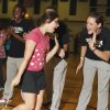 Special Olympics athlete Paige Henderson gets a high five from University of Oklahoma (OU) women\'s college basketball player Whitney Hand during a pep assembly at Longfellow Middle School on Monday, May 10, 2010, in Norman, Okla. Photo by Steve Sisney, The Oklahoman