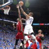 Oklahoma City\'s Russell Westbrook (0) goes past Miami\'s Chris Bosh (1) during Game 1 of the NBA Finals between the Oklahoma City Thunder and the Miami Heat at Chesapeake Energy Arena in Oklahoma City, Tuesday, June 12, 2012. Photo by Chris Landsberger, The Oklahoman