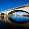 Photo - FILE - In this Oct. 25, 2012 file photo, provided Courtesy of the Lake Havasu City Convention and Visitors Bureau, shows London Bridge, which spans the Colorado River at Lake Havasu City, Ariz. The London Bridge is not falling down, despite a British tabloid saying that the Lake Havasu City tourist attraction is being bulldozed to make way for drug tourism. Lake Havasu City officials heard about the story in The Sun after a local resident visiting the United Kingdom brought back a copy of the tabloid. They say it was a slap in the face and demanded a retraction and an apology. (AP Photo/Courtesy of the Lake Havasu City Convention and Visitors Bureau)