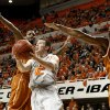 Oklahoma State\'s Keiton Page (12) goes between Texas\' Jaylen Bond (2) and Jonathan Holmes (10) during an NCAA college basketball game between Oklahoma State University (OSU) and the University of Texas (UT) at Gallagher-Iba Arena in Stillwater, Okla., Saturday, Feb. 18, 2012. Oklahoma State won 90-78. Photo by Bryan Terry, The Oklahoman