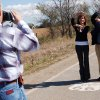 Kaisa Kaisa Barthuli and Christoper Marston both with the National Park Service make a 66 with their arms on the last stretch of the original Route 66 Ribbon Road west of Miami, Oklahoma Thursday, Oct. 23, 2008. They were on a tour from the National Preservation Conference in Tulsa this week. BY GARY CROW, FOR THE OKLAHOMAN
