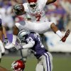 OU\'s DeMarco Murray leaps over Ray Cheatham of Kansas State during the college football game between the University of Oklahoma and Kansas State University in Manhattan, Kansas, Saturday, October 25, 2008. BY BRYAN TERRY, THE OKLAHOMAN ORG XMIT: KOD