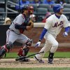 New York Mets\' Ike Davis, right, hits a single off Atlanta Braves relief pitcher Craig Kimbrel in the tenth inning of a baseball game that was suspended from Friday night at Citi Field, Saturday, May 25, 2013 in New York. The Braves won 7-5. (AP Photo/Kathy Kmonicek)