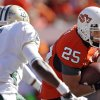 Oklahoma State\'s Josh Cooper (25) runs past Baylor\'s Ahmad Dixon (6) during the college football game between the Oklahoma State University Cowboys (OSU) and the Baylor University Bears at Boone Pickens Stadium in Stillwater, Okla., Saturday, Nov. 6, 2010. Photo by Chris Landsberger, The Oklahoman