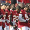 Photo - Kansas City Chiefs players stand arm-in-arm during a moment of silence before an NFL football game against the Carolina Panthers at Arrowhead Stadium in Kansas City, Mo., Sunday, Dec. 2, 2012. (AP Photo/Colin E. Braley)