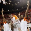 From left, OSU\'s Markel Brown, Brian Williams and Michael Cobbins hold up Keiton Page during senior day before a men\'s college basketball game between the Oklahoma State University Cowboys and the University of Kansas Jayhawks at Gallagher-Iba Arena in Stillwater, Okla., Monday, Feb. 27, 2012. Photo by Nate Billings, The Oklahoman