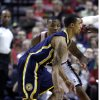 Indiana Pacers guard George Hill, front, drives past Portland Trail Blazers guard Damian Lillard during the first quarter of an NBA basketball game in Portland, Ore., Wednesday, Jan. 23, 2013. (AP Photo/Don Ryan)