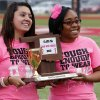 Win-Win State-wide winners Sabrina Bermudez, student council president, and Miavonna Craig, event planner, are presented with a trophy for their school before the game by the OSSAA as the Del City Eagles play the Midwest City Bombers in high school football on Friday, Sept. 20, 2013 in Del City, Okla. Photo by Steve Sisney, The Oklahoman