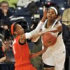 Photo - Notre Dame forward Ariel Braker blocks a pass from Miami guard Caprice Dennis, left, during the first half of an NCAA college basketball game, Thursday, Jan. 23, 2014 in South Bend, Ind. (AP Photo/Joe Raymond)