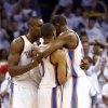 Oklahoma City\'s Serge Ibaka (9) and Kevin Durant (35) hug Russell Westbrook (0) after he was fouled on a 3-point shot late in the fourth quarter during Game 5 of the Western Conference semifinals in the NBA playoffs between the Oklahoma City Thunder and the Los Angeles Clippers at Chesapeake Energy Arena in Oklahoma City, Tuesday, May 13, 2014. Photo by Sarah Phipps, The Oklahoman