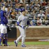 Chicago Cubs\' Anthony Rizzo, right, tosses his bat after hitting a pop fly as New York Mets catcher Travis d\'Arnaud points to the ball during the seventh inning of a baseball game Saturday, Aug. 16, 2014, in New York. (AP Photo/Frank Franklin II)