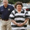 Former McLoud school teacher Kim Crain, shown here being escorted by Lincoln County Deputy Dave Balleweg, and her alleged accomplice, Gary Doby, a former professor at OBU, arrive at the Pottawatomie County Courthouse Monday morning, May 21, 2012, for a preliminary hearing. Photo by Jim Beckel, The Oklahoman