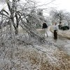 WINTER / COLD / WEATHER / ICE STORM 2007: John Conrad Golf Course in Midwest City is unplayable for an undetermined period until tree branches can be removed from the course. According to Larry Denney, course director, left, at least 80 per cent of trees on the course sustained some damage from heavy ice. Denney and C.B. Hutchins, groundskeeper, look at some of the damage near the first green Tuesday morning, Dec. 11, 2007. By Jim Beckel, The Oklahoman. ORG XMIT: KOD