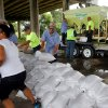 City of D\'Iberville employees fill sand bags for citizens under the 110 bridge at the D\'Iberville, Miss. Marina on Tuesday, Aug. 28, 2012. The U.S. National Hurricane Center in Miami said Isaac became a Category 1 hurricane Tuesday with winds of 75 mph. It could get stronger by the time it\'s expected to reach the swampy coast of southeast Louisiana. (AP Photo/Sun Herald, Amanda McCoy) ORG XMIT: MSGUL101