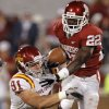 Oklahoma\'s Roy Finch (22) gets past Iowa State\'s Patrick Neal (91) during the second half of the college football game between the University of Oklahoma Sooners (OU) and the Iowa State Cyclones (ISU) at the Gaylord Family-Oklahoma Memorial Stadium on Saturday, Oct. 16, 2010, in Norman, Okla. Photo by Chris Landsberger, The Oklahoman