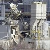 The International Nutrition plant is shown with wreckage in Omaha, Neb., where a fire and explosion took place Monday, Jan. 20, 2014. At least nine people have been hospitalized and others could be trapped at the animal feed processing plant. (AP Photo/Nati Harnik)