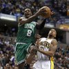 Boston Celtics\' Jeff Green (8) goes up for a shot against Indiana Pacers\' David West (21) during the first half of an NBA basketball game Wednesday, March 6, 2013, in Indianapolis. (AP Photo/Darron Cummings)