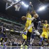Oklahoma City Thunder\'s Russell Westbrook (0) passes to Kendrick Perkins (5) while defended by Indiana Pacers\' Roy Hibbert (55) during the first half of an NBA basketball game on Friday, April 5, 2013, in Indianapolis. (AP Photo/Darron Cummings)