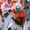 Photo - ** FILE **      OSU: In this Nov. 1, 2008 file photo, Oklahoma State University wide receiver, Dez Bryant (1), runs the football during an NCAA college football game against Iowa in Stillwater. Bryant, who is 6-foot-2, has a knack for winning jumpballs against opposing defensive backs and also showed off his speed last week by getting behind the Iowa State defense for an 80-yard touchdown catch. (AP Photo/Brody Schmidt, File) ORG XMIT: NY172
