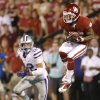 Oklahoma\'s Kenny Stills (4) makes a catch in front of Kansas State\'s Ty Zimmerman (12) during a college football game between the University of Oklahoma Sooners (OU) and the Kansas State University Wildcats (KSU) at Gaylord Family-Oklahoma Memorial Stadium, Saturday, September 22, 2012. Photo by Bryan Terry, The Oklahoman