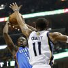 Oklahoma City\'s Reggie Jackson (15) shoots against Memphis\' Mike Conley (11) during Game 3 in the second round of the NBA basketball playoffs between the Oklahoma City Thunder and Memphis Grizzles at the FedExForum in Memphis, Tenn., Saturday, May 11, 2013. Photo by Nate Billings, The Oklahoman