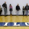 Voters wait in line prior to casting their ballots on Election Day, Tuesday, Nov. 6, 2012, at the Mona Shores Middle School gym in Norton Shores, Mich. Some waited at least one hour to vote. (AP Photo/The Muskegon Chronicle, Ken Stevens) ALL LOCAL TV OUT; LOCAL TV INTERNET OUT