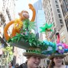 Wearing rainforest inspired hats, Kaitlyn Fishkin, 11, left, and her sister Erica Fishkin, 13, pose for photographs as they take part in the Easter Parade along New York\'s Fifth Avenue Sunday April 24, 2011. (AP Photo/Tina Fineberg)