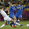 England\'s Steven Gerrard tries to stop Italy\'s Riccardo Montolivo during the Euro 2012 soccer championship quarterfinal match between England and Italy in Kiev, Ukraine, Sunday, June 24, 2012. (AP Photo/Kirsty Wigglesworth)