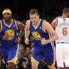 Photo - Golden State Warriors' David Lee (10) and Jermaine O'Neal (7) react after Lee scored during the first half of an NBA basketball game against the New York Knicks, Friday, Feb. 28, 2014, in New York. (AP Photo/Frank Franklin II)