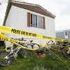 Bicycles sit behind the home of Blake and Blaine Romes in Ottawa, Ohio, Friday, May 10, 2013. Two teenage brothers who had been reported missing were found dead after a third teen pointed authorities to their bodies before he was taken into custody, officials said. The three teens, 14-year-old Blaine Romes, 17-year-old Blake Romes and 17-year-old Michael Fay, lived together with their mothers inside a trailer home in Ottawa in northwest Ohio, neighbors said. The three had been the subject of an Amber Alert issued Thursday morning after a relative returned to the home and found a crime scene, the Putnam County Sheriff\'s Office said. Fay was taken into custody Thursday afternoon. (AP Photo/Rick Osentoski)