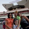 In this photo taken Jan. 30, 2013, Amalia Reigosa, center, accompanied by her sisters Jaynet, right, Anabel, left, and her niece Gabriela pose in front of the Jose Marti International Airport in Havana, Cuba, before her trip to Milan, Italy. Reigosa a 19-year-old language student was one of the first Cubans to take advantage of a travel reform that went into effect a year ago. Cubans are now traveling abroad in record numbers. (AP Photo/Ramon Espinosa)