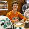 Irish senior quarterback Jacob Lewis signed a letter of intent to play at Princeton during a signing day ceremony at Bishop McGuinness High School on Wednesday, Feb. 5, 2014. Photo by Jim Beckel, The Oklahoman