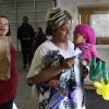 A woman carries a child as a volunteer follows her carrying her groceries and turkey. Jesus House distributed turkeys and grocery items Tuesday morning, Nov. 19, 2012. Officials said they had 400 turkeys and food baskets to distribute and people were standing in line when their doors opened at 8 a.m. In less than two yours, all turkeys had been claimed. They will pass out 400 more turkeys and food baskets on Wednesday. Photo by Jim Beckel, The Oklahoman