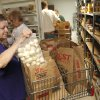 Photo -  Client Dede Taylor chooses food items at Project 66 in Edmond. Photo by Paul Hellstern, The Oklahoman   PAUL HELLSTERN -
