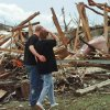 MAY 3, 1999 TORNADO: Tornado victims, damage: Jason Meinhardt comforts his fiance, Melanie Sieger, as they view a destroyed home across from Sieger\'s home near SE 41 and Angela in Del City.