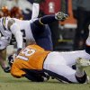 Photo - San Diego Chargers strong safety Marcus Gilchrist (38) sacks Denver Broncos quarterback Peyton Manning (18) in the second quarter of an NFL football game, Thursday, Dec. 12, 2013, in Denver. (AP Photo/Joe Mahoney)